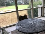 Screen porch overlooks 11th golf green on famed Links course