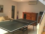 Games room has ping pong table for fun family time.