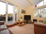 Open plan living with doors out onto balcony