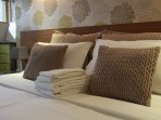 White cotton bed linen, bath and hand towels