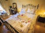 Ghammar bedroom showing towel arrangement and bathrobe. Dressing table, tea and coffee facilities