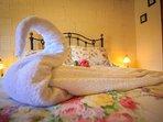 Swan arrangement on bed