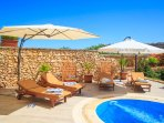 Sun loungers, umbrellas, swimming pool with counter current jets