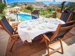 Breakfast alfresco overlooking the swimming pool, the deck area and open views of the Zebbug valley