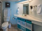 Private master bedroom bath has plenty of storage.  Towels are provided.