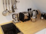 Hob, toasters, Alessi coffee maker and kettle