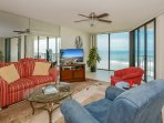 Beautifully decorated, oceanfront living room with recliner and queen sofa sleeper.