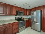 Updated, fully equipped kitchen with updated appliances and granite counter tops.