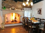 Indoor dining area with a fireplace for those cold evenings