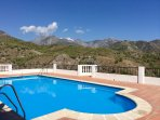 The beautiful shared pool with an unobstructed view of the mountains