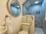 Rinse off in the sleek walk-in shower.