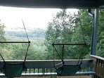 NEW... hanging chairs on the covered porch for enjoying the view