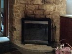 large stone fireplace for cozy nights and/or romantic evenings