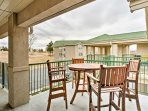 The furnished patio is a great place to enjoy a family meal.