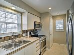 The brand new stainless steel appliances make the kitchen feel like a Food Network studio.