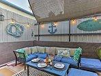 The tasteful nautical decor enhances the beach-style cottage atmosphere.