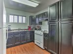 The fully equipped kitchen is ready to help you prepare meals with ease.