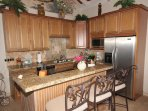 The Upper level kitchen is the twin sister of the Lower level kitchen