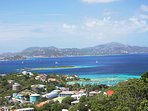 Your view overlooks Cruz Bay Harbor in the foreground, with St Thomas and other islands in the distance