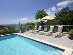 The pool and pool deck of Villa Venturoso