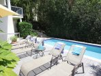 Lush landscaping keeps the pool area semi-private
