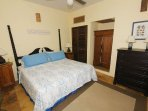 The second master bedroom is comfortably furnished