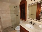 Unit Two – A mahogany, marble and tile bath adjoins each bedroom