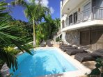 The condos share a 16 ft pool located in a private garden setting