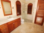 The mahogany, marble & glass bath of the Penthouse