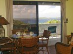 You can even enjoy the view from your couch and dining area!