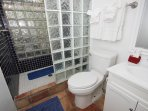 The tiled bathroom adjoins the master bedroom