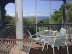 The screened porch off the living room is a great place to dine or relax