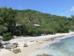 The Beach Cottage is tucked into the shoreline of Lime Tree Cove