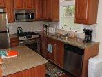 The granite and mahogany kitchen