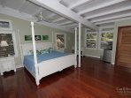 Floors of Brazilian cherry give the master bedroom a rich glow