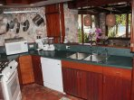The mahogany and stone kitchen at Gull Cottage