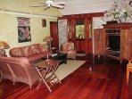Stone walls and varnished mahogany floors create a classic Caribbean ambiance