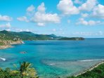 The view to the east overlooks Hart Bay and takes in most of the rugged south coast of St John