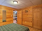 This basement bedroom boasts a full bed.
