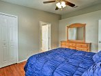 Rest and recuperate in the first bedroom with a queen bed.