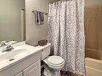 Both bathrooms are stocked with complimentary toiletries and fresh towels.