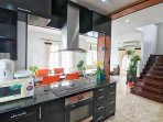 Open plan kitchen with electric stove and Oven