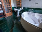 Large main bathroom, with its double ended bath to wile away your evenings.