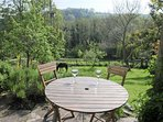 looking across the valley to hills beyond.  This secluded garden offers peace and tranquility.