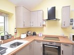 High quality kitchen with high gloss doors, top of the range oven and sink