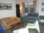 Living room and sleeping alcove.