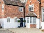 Hidden Gem is a beautiful historic duplex apartment that resembles a cottage!
