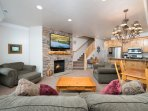 Living area with large flat screen and gas fireplace