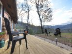 Large side deck with mountain and sunset views