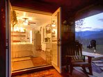 Covered front porch entry with 2 rocking chairs. Side deck with mountain views and fire pit